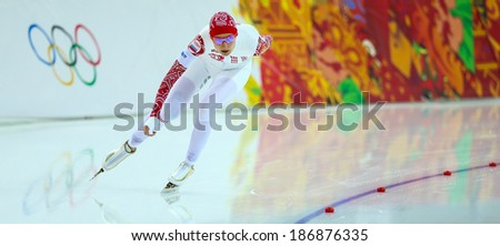 Sochi, RUSSIA - February 19, 2014: Anna CHERNOVA (RUS) on lane during Speed Skating. Ladies' 5000 m at the Sochi 2014 Olympic Games - stock photo