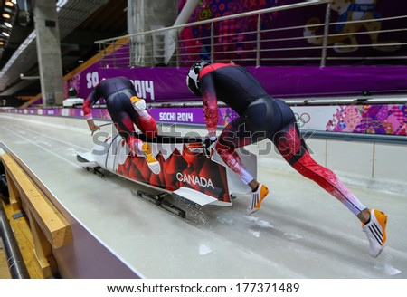Sochi, RUSSIA - February 16, 2014: Canada 3 team at two-man bobsleigh heat at Sochi 2014 XXII Olympic Winter Games - stock photo