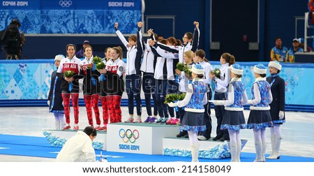 Sochi, RUSSIA - February 18, Canadian, Korean, Italian teams during medal ceremony after Ladies' 3000 m Short Track Relay Final at the Sochi 2014 Olympic Games - stock photo