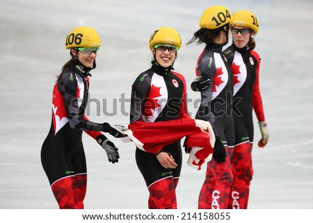 Sochi, RUSSIA - February 18, Canadian team celebrates silver medal at Ladies' 3000 m Short Track Relay Final at the Sochi 2014 Olympic Games - stock photo