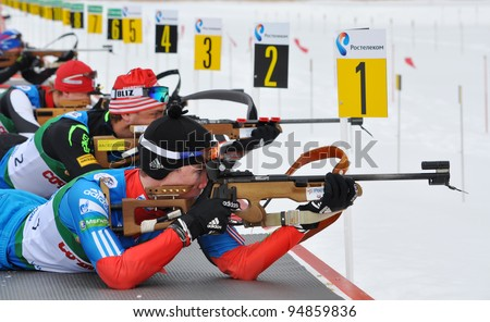 """SOCHI, RUSSIA - FEBRUARY 10: Cup of Russia on biathlon in Sochi on February 10, 2012. The combined ski-biathlon complex """"Laura"""" for the Olympic Games 2014. Male race of prosecution. A firing line. - stock photo"""