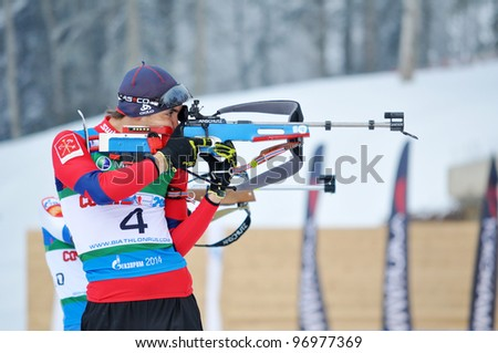 "SOCHI, RUSSIA - FEBRUARY 10: Cup of Russia on biathlon in Sochi on February 10, 2012. The combined ski-biathlon complex ""Laura"" for the Olympic Games 2014. Alexander Kuzmin on a firing line"