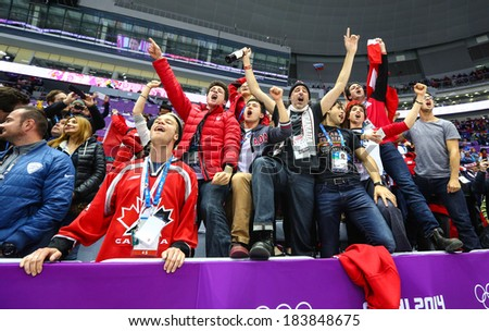 Sochi, RUSSIA - February 20, 2014: Fans of Canadian Women's Ice hockey team celebrates their team victory in Gold Medal Game vs. USA team at the Sochi 2014 Olympic Games - stock photo