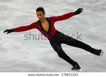 Sochi, RUSSIA - February 13, 2014: Florent AMODIO (FRA) on ice during figure skating competition of men in short program at Sochi 2014 XXII Olympic Winter Games - stock photo