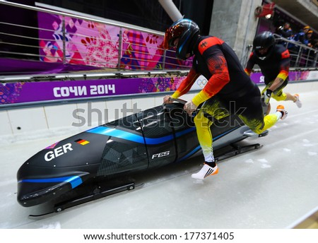 Sochi, RUSSIA - February 16, 2014: Germany 3 team at two-man bobsleigh heat at Sochi 2014 XXII Olympic Winter Games - stock photo