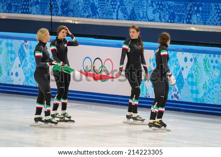 Sochi, RUSSIA - February 18, Italian team celebrates bronze medal at Ladies' 3000 m Short Track Relay Final at the Sochi 2014 Olympic Games - stock photo