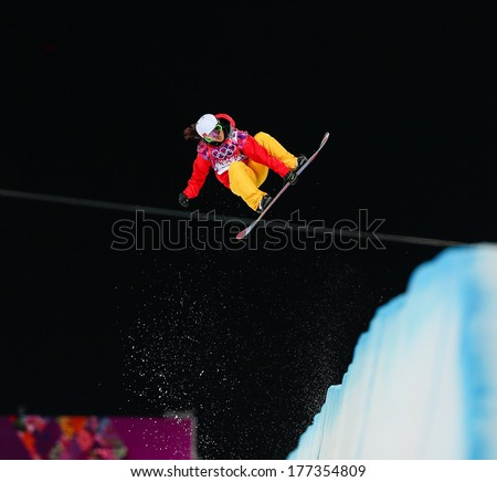 Sochi, RUSSIA - February 12, 2014: Jiayu LIU (CHN) at snowboard competition during Ladies' Halfpipe Qualification at Sochi 2014 XXII Olympic Winter Games - stock photo
