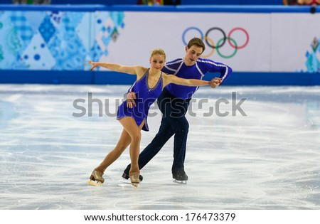 Sochi, RUSSIA - February 11, 2014: Julia LAVRENTIEVA and Yuri RUDYK (UKR) on ice during figure skating competition of pairs in short program at Sochi 2014 XXII Olympic Winter Games - stock photo