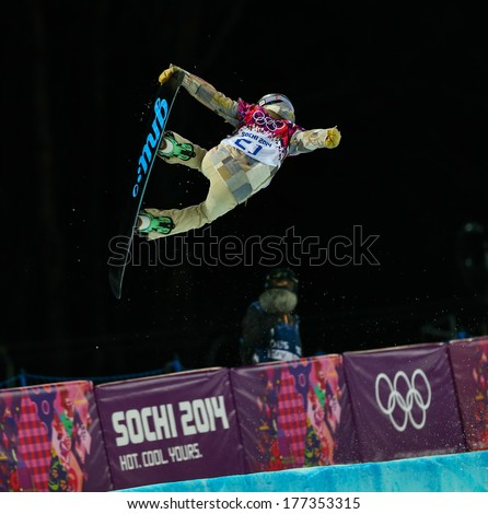 Sochi, RUSSIA - February 12, 2014: Kaitlyn FARRINGTON (USA) at snowboard competition during Ladies' Halfpipe Qualification at Sochi 2014 XXII Olympic Winter Games - stock photo
