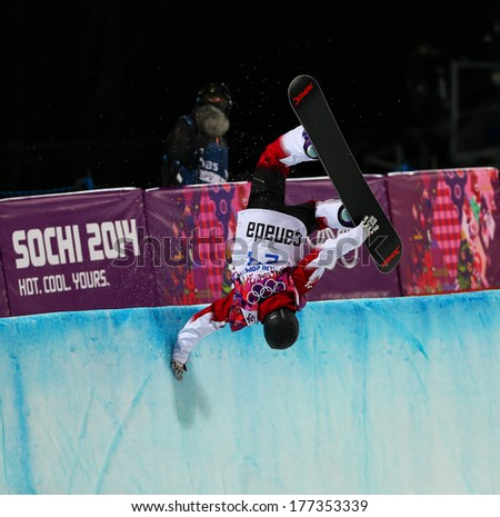 Sochi, RUSSIA - February 12, 2014: Katie TSUYUKI (CAN) at snowboard competition during Ladies' Halfpipe Qualification at Sochi 2014 XXII Olympic Winter Games - stock photo