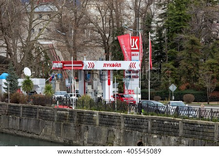 Sochi, Russia - February 8, 2016: Lukoil gas station with fueling car. LUKOIL - one of the largest Russian oil company. - stock photo