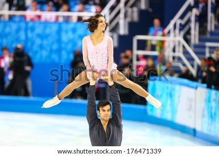 Sochi, RUSSIA - February 11, 2014: Meagan DUHAMEL and Eric RADFORD (CAN) on ice during figure skating competition of pairs in short program at Sochi 2014 XXII Olympic Winter Games - stock photo