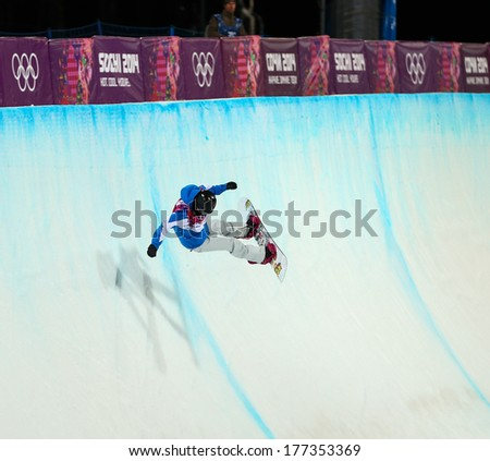 Sochi, RUSSIA - February 12, 2014: Mirabelle THOVEX (FRA) at snowboard competition during Ladies' Halfpipe Qualification at Sochi 2014 XXII Olympic Winter Games - stock photo