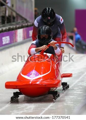 Sochi, RUSSIA - February 16, 2014: Monaco 1 team at two-man bobsleigh heat at Sochi 2014 XXII Olympic Winter Games - stock photo