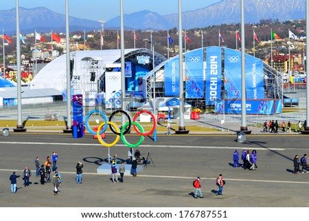 SOCHI, RUSSIA - FEBRUARY 7, 2014: Peoples on Medals Plaza in Olympic park a few hours before the opening ceremony of the Olympic Games 2014 - stock photo