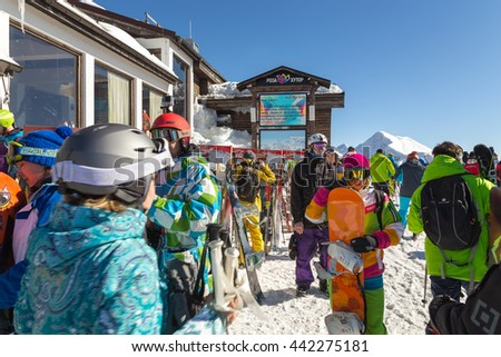 Sochi, Russia - February 10, 2016: Skiers and snowboarders in the ski resort of Rosa Khutor. Krasnaya Polyana. - stock photo