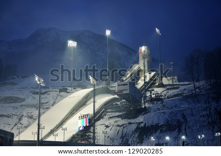 """SOCHI, RUSSIA - FEBRUARY 2:  Springboard complex """"RusSki Gorki""""  for ski jumping in Sochi on February, 2, 2012. Construction is behind schedule by two years, now it costs 8 billion rubles - stock photo"""