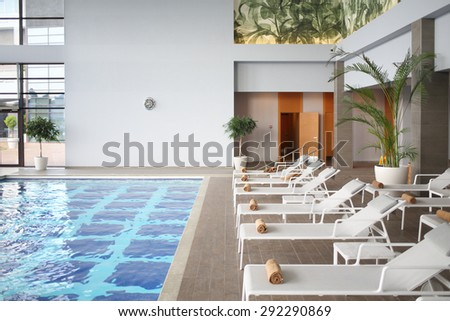 SOCHI, RUSSIA - JUL 27, 2014: Interior space with an indoor pool and loungers in the Hotel Radisson Blu Paradise Resort and Spa - stock photo