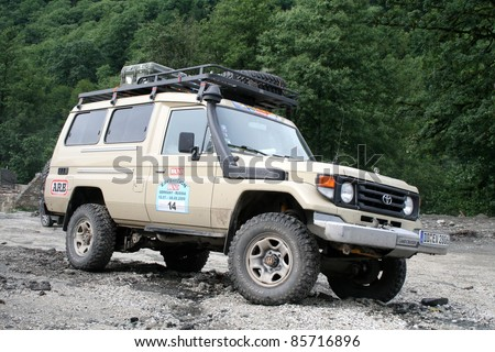 SOCHI, RUSSIA - JULY 20: Member of international off-road expedition Germany-Russia (12 July - 08 August 2009) on July 20, 2009 in Sochi, Russia. - stock photo