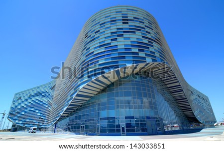 SOCHI, RUSSIA - JUNE  20: Finishing facade of ice rink for figure skating on June 20, 2013 in Sochi, Russia for Winter Olympic Games 2014 - stock photo