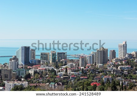 SOCHI, RUSSIA - MAR 23, 2014: View from above of a waterfront and modern hotel complexes - stock photo