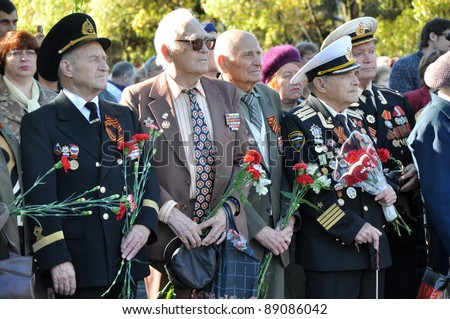 SOCHI, RUSSIA - MAY 9: Unidentified veterans lay flowers at Victory Monument during the celebration of Victory Day on May 9, 2010 in Sochi, Russia.
