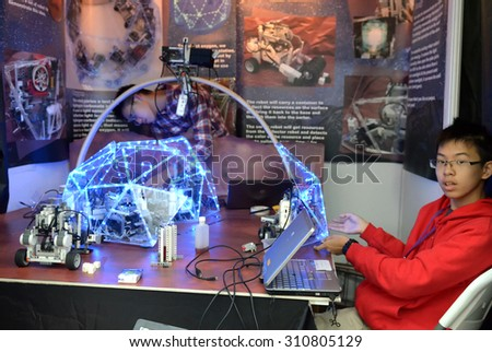 SOCHI, RUSSIA - November 21, 2014: Children make a robot at the robot Olympiad in Sochi. Here there was the World Robotic Olympiad 2014. It was attended by delegates from 47 countries. - stock photo