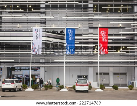 SOCHI, RUSSIA - SEPTEMBER 28, 2014: Flags of Russian colours at input on main tribune of autodrome of Grand prix of Formula 1 in Sochi in Russia to be held on 12 October 2014  - stock photo