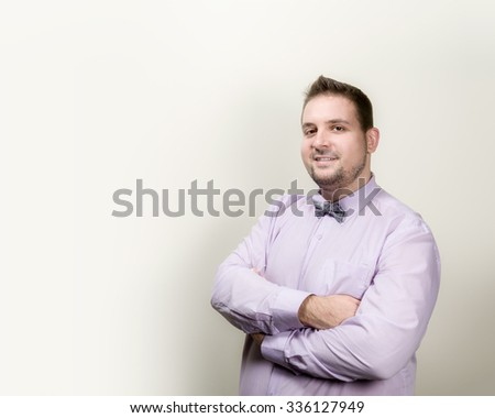 Sociable successfully businessman smiling happily .