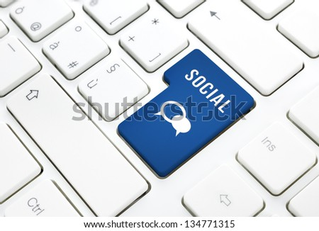 Social business concept, text and balloon icon, blue enter button or key on white keyboard photography. - stock photo
