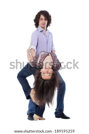 Social dance West Coast Swing. Demonstration of a dip pose. Focus on the girl`s face. - stock photo