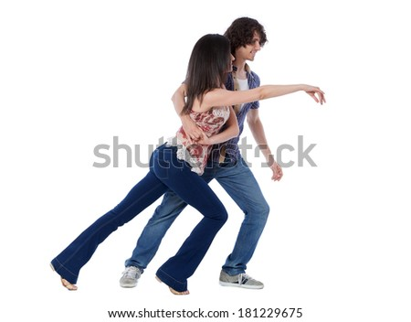 Social dance West Coast Swing. The girl must get back under the man's arm. - stock photo