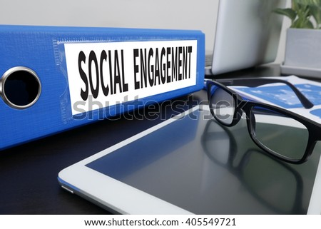 SOCIAL ENGAGEMENT Office folder on Desktop on table with Office Supplies. ipad