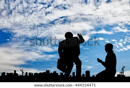 Social inequality. Silhouette of the rich and the poor man on the background cityscape