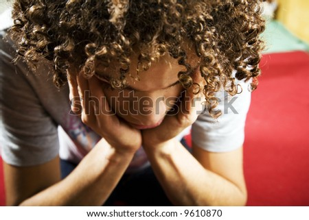 social issues: depressed guy with hands on temples - stock photo