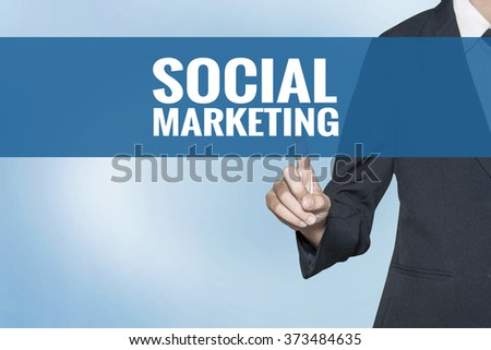 Social Marketing word on virtual screen touch by business woman blue background - stock photo