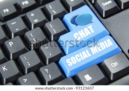Social media and chat with logo on blue keyboard button. - stock photo