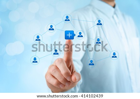 Social media and community concept. Businessman click on plus button to connect new person with community, bokeh background.