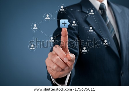 Social media and community concept. Man click on plus button to connect new person with community. - stock photo