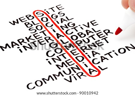Social Media and other related words in a handwritten crossword concept. - stock photo