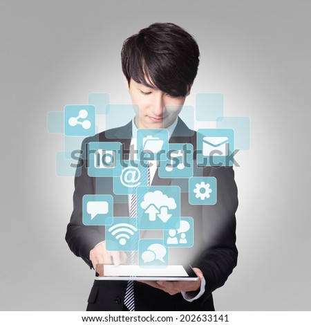 Social media concept - Business man touch digital tablet pc with APP icon interface screen, asian - stock photo