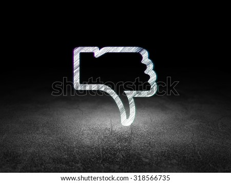 Social media concept: Glowing Thumb Down icon in grunge dark room with Dirty Floor, black background - stock photo