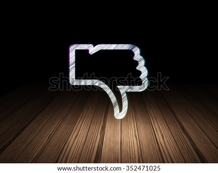 Social media concept: Glowing Thumb Down icon in grunge dark room with Wooden Floor, black background - stock photo