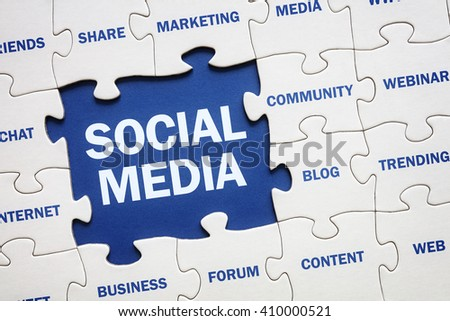 Social media concept jigsaw piece reading marketing, networking, community, internet etc - stock photo
