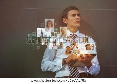 Social Media Concept. Man using modern technology for communication - stock photo