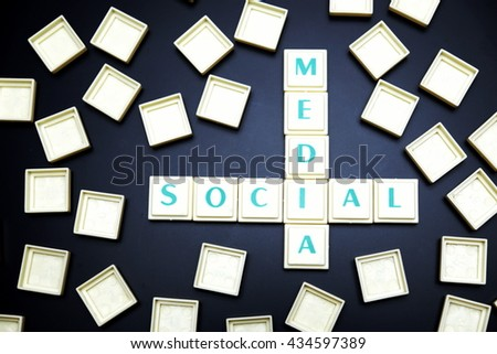 Social media concept. The words spelled by letters on black board background. - stock photo