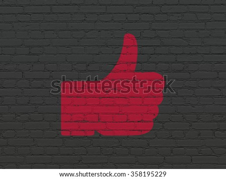 Social media concept: Thumb Up on wall background - stock photo
