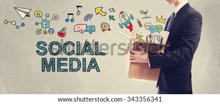 Social Media concept with businessman holding a cardboard box - stock photo