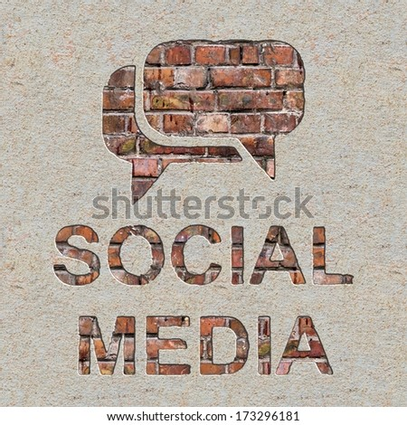 Social Media Concept with Speech Bubble Icon on the Brick and Plastered Wall. - stock photo