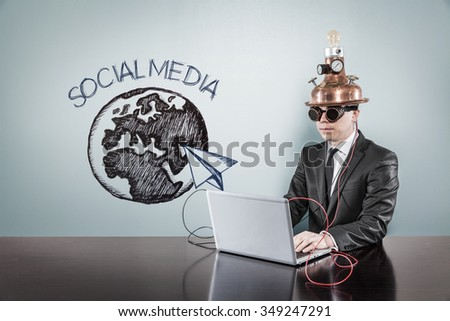 Social media concept with vintage businessman and laptop at office - stock photo